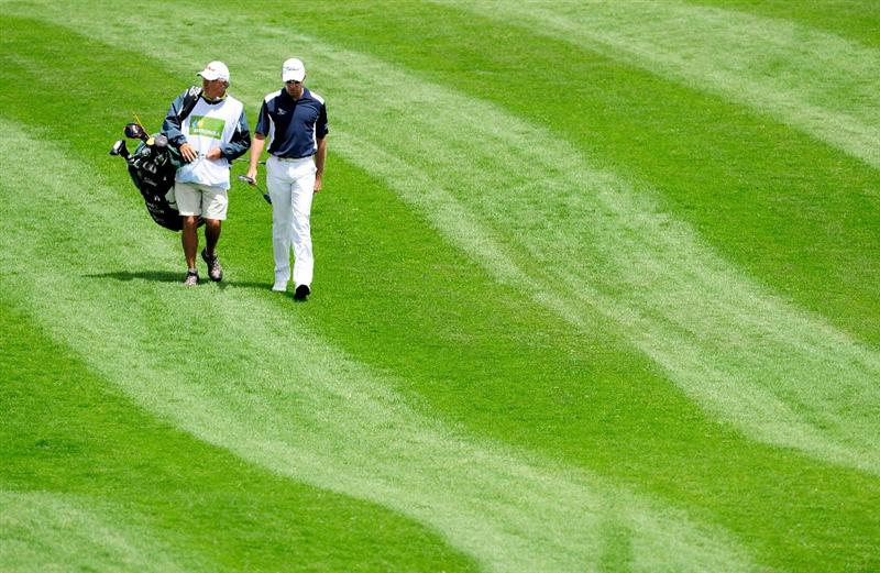 MALLORCA, SPAIN - MAY 15:  James Kingston of South Africa and caddie walk down a fairway during the third round of the Open Cala Millor Mallorca at Pula golf club on May 15, 2010 in Mallorca, Spain.  (Photo by Stuart Franklin/Getty Images)