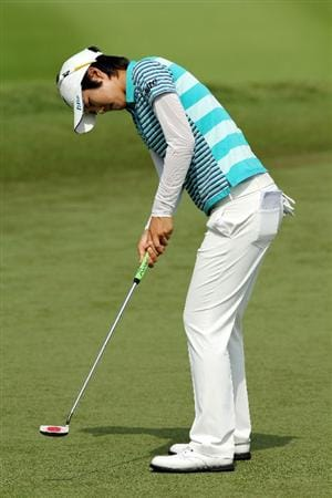 KUALA LUMPUR, MALAYSIA - OCTOBER 23:  Song-Hee Kim of Korea Republic putts on the 11th hole during Round Two of the Sime Darby LPGA at the Kuala Lumpur Golf and Country Club on October 23, 2010 in Kuala Lumpur, Malaysia. (Photo by Stanley Chou/Getty Images)