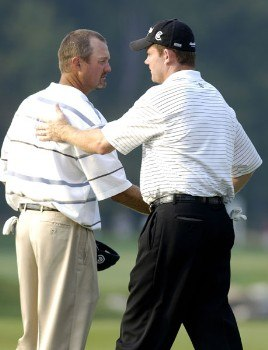 Shaun Micheel, right, shakes hands with Jerry Kelly during the first round of the 2005 84 Lumber Classic on Thursday, September 15, 2005  held at the Mystic Rock Golf Course/Nemacolin Woodlands Resort  in Farmington, Pennsylvania. Micheel bogied the final three holes but maintained a share of the lead.Photo by Marc Feldman/WireImage.com