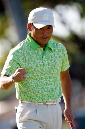 HONOLULU - JANUARY 17:  Shigeki Maruyama of Japan reacts to a birdie on the 9th hole during the third round of the Sony Open at Waialae Country Club on January 17, 2009 in Honolulu, Hawaii.  (Photo by Sam Greenwood/Getty Images)