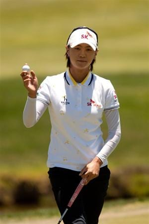 MORELIA, MEXICO - MAY 01: Na Yeon Choi of South Korea  raises her ball to acknowledge the crowd during the third round of the Tres Marias Championship at the Tres Marias Country Club on May 1, 2010 in Morelia, Mexico. (Photo by Darren Carroll/Getty Images)
