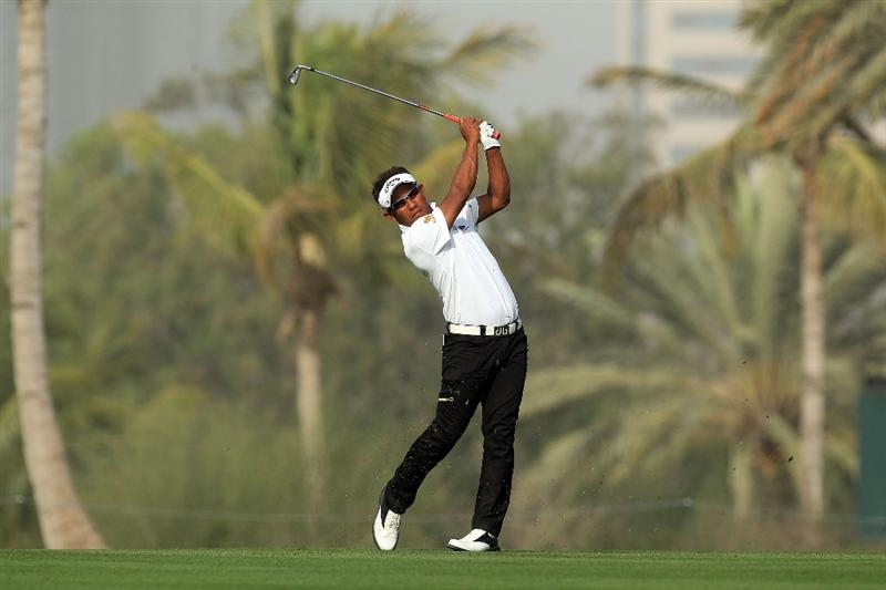 DUBAI, UNITED ARAB EMIRATES - FEBRUARY 04: Thongchai Jaidee of Thailand plays his second shot at the par 5, 13th hole during the first round of the 2010 Omega Dubai Desert Classic on the Majilis Course at the Emirates Golf Club on February 4, 2010 in Dubai, United Arab Emirates.  (Photo by David Cannon/Getty Images)