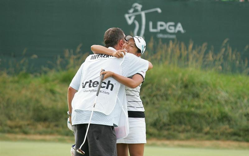 GALLOWAY, NJ - JUNE 20:  Ai Miyazato of Japan hugs her caddie Michael Seaborn as she celebrates winning the ShopRite LPGA Classic held at Dolce Seaview Resort (Bay Course) on June 20, 2010 in Galloway, New Jersey.  (Photo by Michael Cohen/Getty Images)