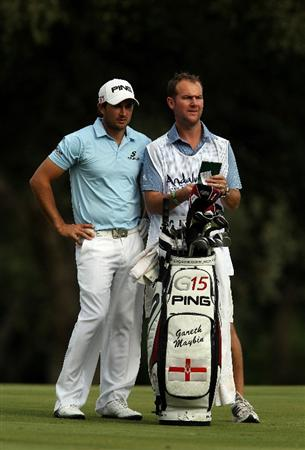 SOTOGRANDE, SPAIN - OCTOBER 30:  Gareth Maybin of Northern Ireland talks with his caddy Darren Reynolds before playing into the 14th green during the third round of the Andalucia Valderrama Masters at Club de Golf Valderrama on October 30, 2010 in Sotogrande, Spain.  (Photo by Richard Heathcote/Getty Images)