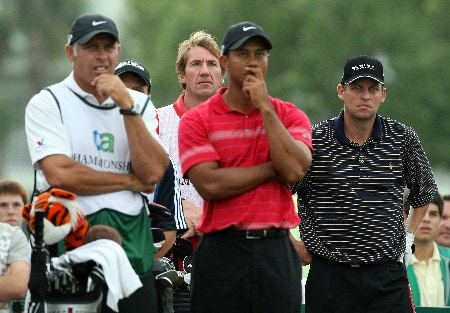 MIAMI - MARCH 24:  Anders Hansen (R) of Denmark waits on the 14th tee with his playing partner Tiger Woods (2nd R) of the USA during the completion of the final round of the 2008 World Golf Championships CA Championship at the Doral Golf Resort & Spa, on March 24, 2008 in Miami, Florida.  (Photo by David Cannon/Getty Images)