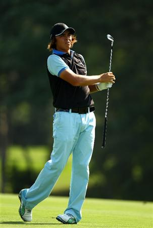 PONTE VEDRA BEACH, FL - MAY 07:  Rickie Fowler hits a fairway shot on the 14th hole during the second round of THE PLAYERS Championship held at THE PLAYERS Stadium course at TPC Sawgrass on May 7, 2010 in Ponte Vedra Beach, Florida.  (Photo by Richard Heathcote/Getty Images)