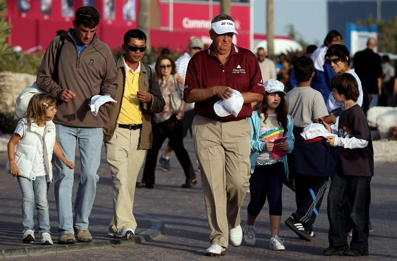 DOHA, QATAR - JANUARY 29: Colin Montgomerie of Scotland signs autographs after the second round of the Commercialbank Qatar Masters at the Doha Golf Club on January 29, 2010 in Doha, Qatar.  (Photo by Ross Kinnaird/Getty Images)
