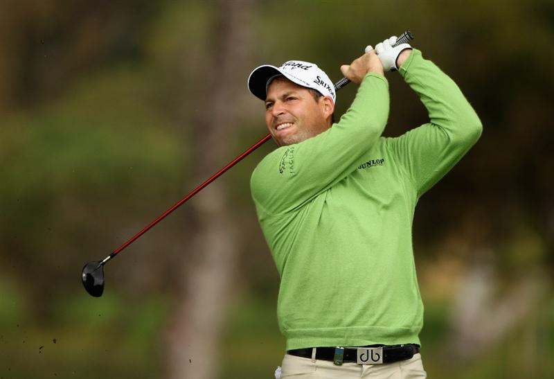 MALAGA, SPAIN - MARCH 25:  David Howell of England plays his second shot into the 18th green during the first round of the Open de Andalucia 2010 at Parador de Malaga Golf on March 25, 2010 in Malaga, Spain.  (Photo by Warren Little/Getty Images)