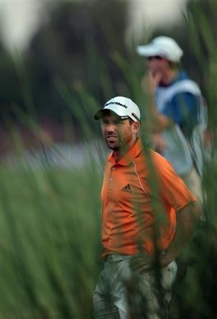 DUBAI, UNITED ARAB EMIRATES - NOVEMBER 26:  Sergio Garcia of Spain plays his second shot to the par 5, 18th hole during the second round of the Dubai World Championship on the Earth Course at Jumeirah Golf Estates on November 26, 2010 in Dubai, United Arab Emirates.  (Photo by David Cannon/Getty Images)