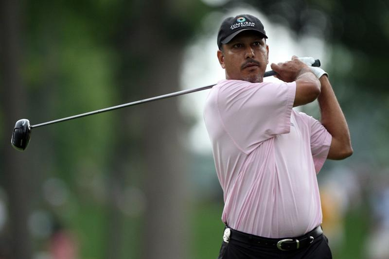 CHASKA, MN - AUGUST 13:  Jeev Milkha Singh of India plays his tee shot on the fifth hole during the first round of the 91st PGA Championship at Hazeltine National Golf Club on August 13, 2009 in Chaska, Minnesota.  (Photo by David Cannon/Getty Images)