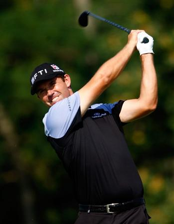 LEMONT, IL - SEPTEMBER 10:  Padraig Harrington of Ireland watches his tee shot on the eighth hole during the first round of the BMW Championship held at Cog Hill Golf & CC on September 10, 2009 in Lemont, Illinois.  (Photo by Scott Halleran/Getty Images)