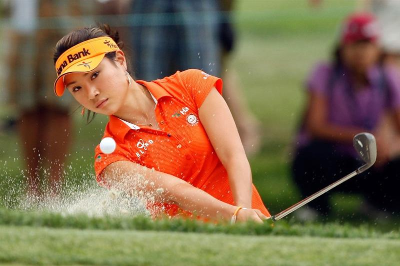 BETHLEHEM, PA - JULY 11:  Hee Young Park of South Korea chips out of a bunker on the 7th hole during the third round of the 2009 U.S. Women's Open at Saucon Valley Country Club on July 11, 2009 in Bethlehem, Pennsylvania.  (Photo by Chris Graythen/Getty Images)