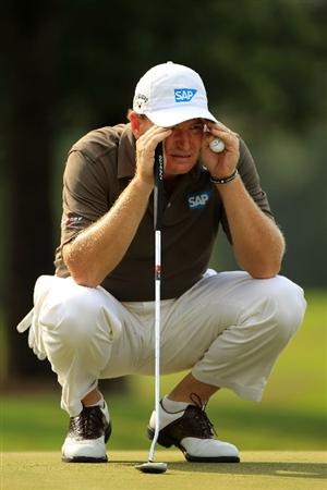 PONTE VEDRA BEACH, FL - MAY 13: Ernie Els of South Africa lines up a putt on the fourth green during the second round of THE PLAYERS Championship held at THE PLAYERS Stadium course at TPC Sawgrass on May 13, 2011 in Ponte Vedra Beach, Florida.  (Photo by Streeter Lecka/Getty Images)