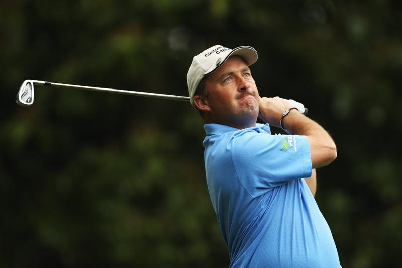 VIRGINIA WATER, ENGLAND - MAY 20:  Damien McGrane of Ireland plays a tee shot at the 2nd hole during the first round of the BMW PGA Championship on the West Course at Wentworth on May 20, 2010 in Virginia Water, England.  (Photo by Ian Walton/Getty Images)