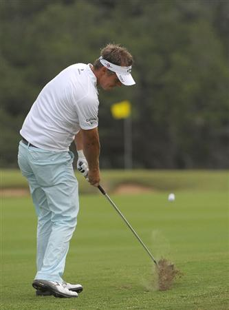SAN ANTONIO, TX- MAY 13:  Fredrik Jacobson hits his approach shot to the 6th hole during the first round of the Valero Texas Open at the TPC San Antonio on May 13, 2010 in San Antonio, Texas. (Photo by Marc Feldman/Getty Images)