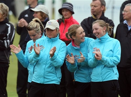 ST. ANDREWS, UNITED KINGDOM - MAY 30: The four Scottish players in the Great Britain and Ireland team (L-R) Carly Booth, Michele Thomson, Sally Watson and Krystle Caithness applaud their teammates by the 18th green during the morning foursome matches for the 2008 Curtis Cup on the Old Course at St Andrews on May 30, 2008 in St Andrews, Scotland.  (Photo by David Cannon/Getty Images)