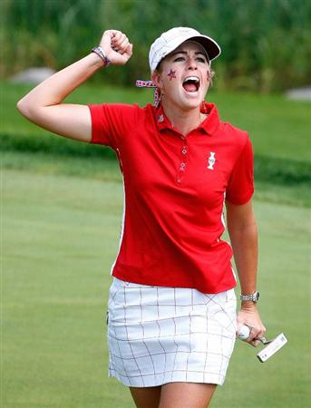 SUGAR GROVE, IL - AUGUST 23:  Paula Creamer of the U.S. Team celebrates her 3&2 victory over Suzann Pettersen of Europe on the 16th green during the Sunday singles matches at the 2009 Solheim Cup at Rich Harvest Farms on August 23, 2009 in Sugar Grove, Illinois.  (Photo by Scott Halleran/Getty Images)
