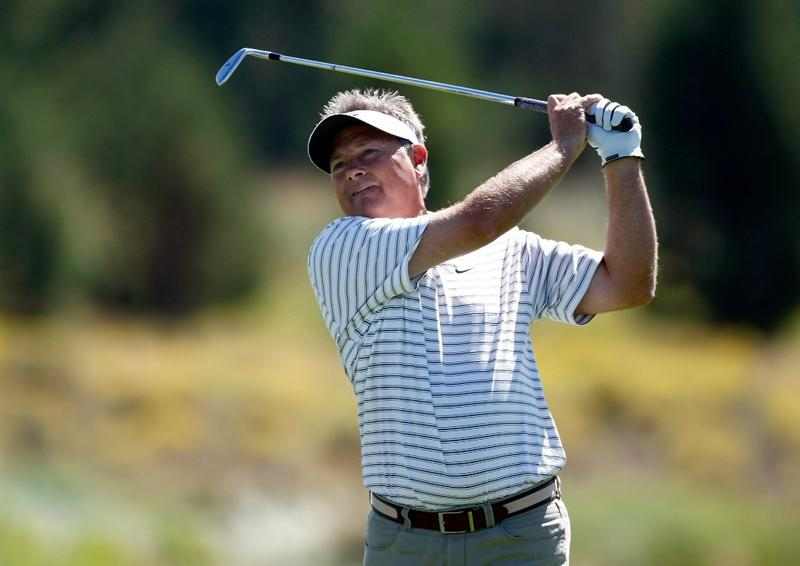 SUNRIVER, OR - AUGUST 21:  John Cook hits his second shot on the 9th hole during the second round of the Jeld-Wen Tradition on August 21, 2009 at Crosswater Club at Sunriver Resort in Sunriver, Oregon.  (Photo by Jonathan Ferrey/Getty Images)