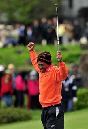 JEJU, SOUTH KOREA - APRIL 26:  Thongchai Jaidee of Thailand celebrates holing his winning putt on the 18th hole during the play - off after the final round of the Ballantine's Championship at Pinx Golf Club on April 26, 2009 in Jeju, South Korea.  (Photo by Stuart Franklin/Getty Images)