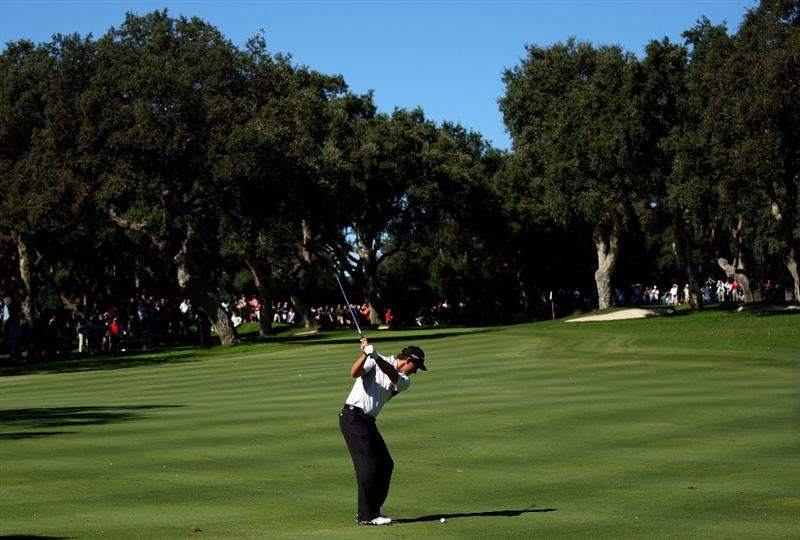 SOTOGRANDE, SPAIN - OCTOBER 30:  Padraig Harrington of Ireland hits his second shot on the first hole during the first round of the Volvo Masters at Valderrama Golf Club on October 30, 2008 in Sotogrande, Spain.  (Photo by Andrew Redington/Getty Images)