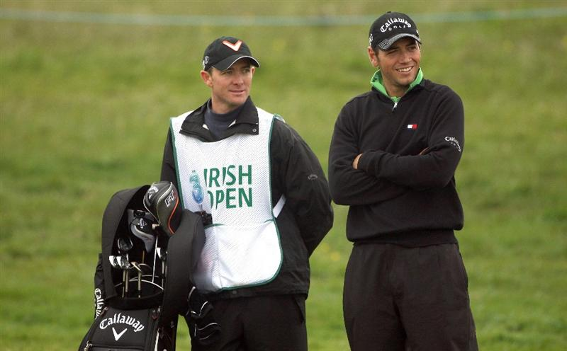 BALTRAY, IRELAND - MAY 14:  Nick Dougherty of England and his caddie Michael Kerr share a joke on the ninth hole during the first round of The 3 Irish Open at County Louth Golf Club on May 14, 2009 in Baltray, Ireland.  (Photo by Andrew Redington/Getty Images)