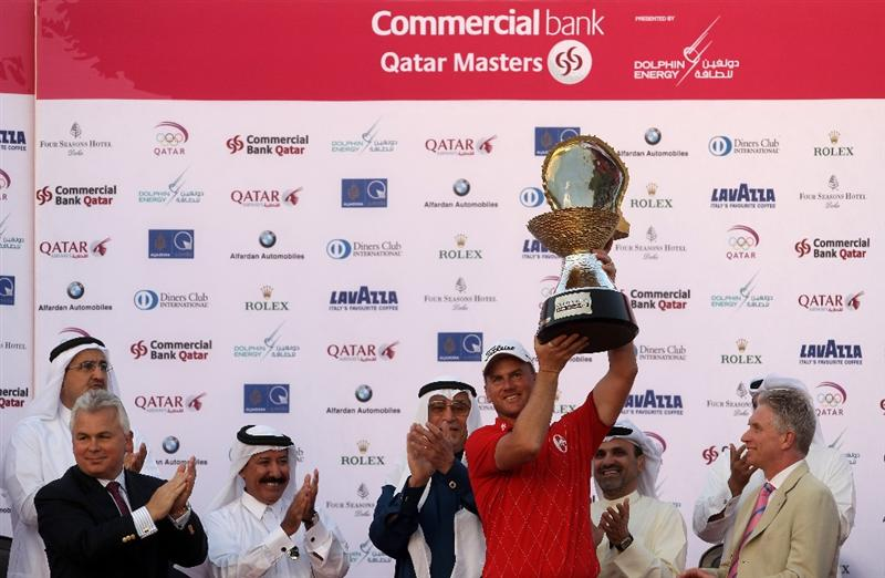 DOHA, QATAR - JANUARY 31:  Robert Karlsson of Sweden lifts with the trophy after winning the Commercialbank Qatar Masters at Doha Golf Club on January 31, 2010 in Doha,Qatar.  (Photo by Andrew Redington/Getty Images)