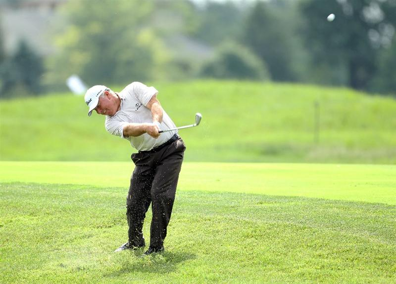 LOUISVILLE, KY - MAY 26:  Mark O'Meara hits his second shot on the par 4 5th hole during the first round of the Senior PGA Championship presented by KitchenAid at Valhalla Golf Club on May 26, 2011 in Louisville, Kentucky.  (Photo by Andy Lyons/Getty Images)
