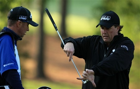 CHARLOTTE, NC - APRIL 30:  Phil Mickelson talks to his caddy Jim 'Bones' MacKay during the pro-am for the Wachovia Championship at Quail Hollow Country Club on April 30, 2008 Charlotte, North Carolina.  (Photo by Richard Heathcote/Getty Images)
