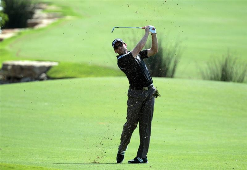 DUBAI, UNITED ARAB EMIRATES - NOVEMBER 25:  Sergio Garcia of Spain plays his third shot to the 18th hole during the first round of the Dubai World Championship on the Earth Course at Jumeirah Golf Estates on November 25, 2010 in Dubai, United Arab Emirates.  (Photo by David Cannon/Getty Images)