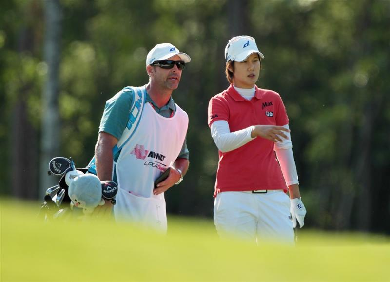 MOBILE, AL - APRIL 30:  Song-Hee Kim of South Korea chats with her caddie Les Luark on the18th hole during the third round of the Avnet LPGA Classic at the Crossings Course at the Robert Trent Jones Trail at Magnolia Grove on April 30, 2011 in Mobile, Alabama.  (Photo by Scott Halleran/Getty Images)