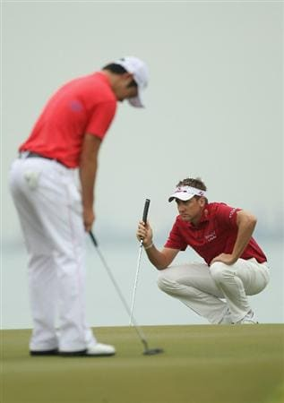 SINGAPORE - NOVEMBER 13:  Ian Poulter of England lines up a put during the Final Round of the Barclays Singapore Open at Sentosa Golf Club on November 14, 2010 in Singapore, Singapore.  (Photo by Ian Walton/Getty Images)