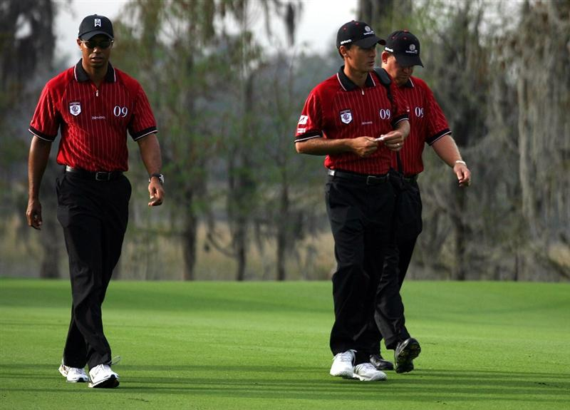 ORLANDO, FL - MARCH 16:  (L-R) Tiger Woods, Charles Howell III and J.B. Holmes arrive by helicoptor for the Tavistock Cup on March 16, 2009 at Lake Nona Country Club in Orlando, Florida.  (Photo by Marc Serota/Getty Images)
