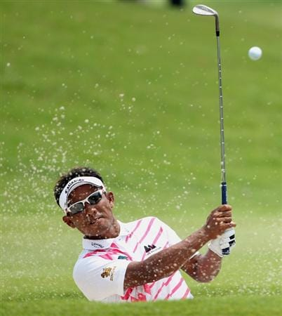 KUALA LUMPUR, MALAYSIA - MARCH 07:  Thongchai Jaidee of Thailand plays a bunker shot on the sixth hole during the the final round of the Maybank Malaysian Open at the Kuala Lumpur Golf and Country Club on March 7, 2010 in Kuala Lumpur, Malaysia.  (Photo by Andrew Redington/Getty Images)