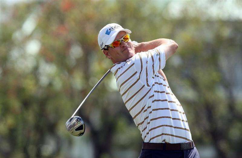 DORAL, FL - MARCH 13:  Zach Johnson of the USA plays his tee shot at the 14th hole during the second round of the World Golf Championships-CA Championship at the Doral Golf Resort & Spa on March 13, 2009 in Miami, Florida  (Photo by David Cannon/Getty Images)