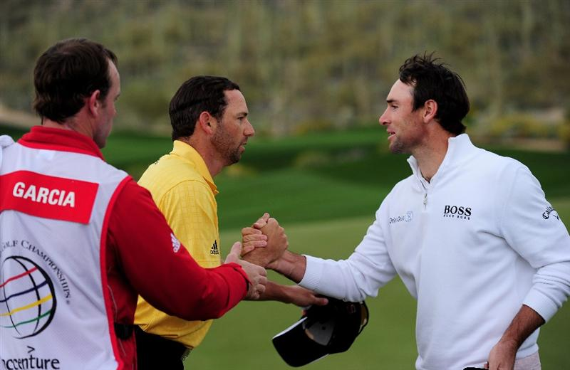 MARANA, AZ - FEBRUARY 20:  Sergio Garcia  of Spain shakes hands with Oliver Wilson of England on the 14th hole during round four of the Accenture Match Play Championship at the Ritz-Carlton Golf Club on February 20, 2010 in Marana, Arizona.  (Photo by Stuart Franklin/Getty Images)