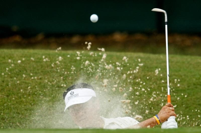 ATLANTA - SEPTEMBER 24:  K.J. Choi of South Korea hits from a bunker on the second hole during the second round of THE TOUR Championship presented by Coca-Cola at East Lake Golf Club on September 24, 2010 in Atlanta, Georgia.  (Photo by Scott Halleran/Getty Images)
