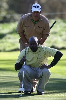 PEBBLE BEACH, CA - FEBRUARY 07:  Chirs DiMarco (Top) gives some advice to former football player Emmitt Smith during the first round of the AT&T Pebble Beach National Pro-Am at Poppy Hills Golf Links on February 7, 2008 in Pebble Beach, California. (Photo by Jed Jacobsohn/Getty Images)