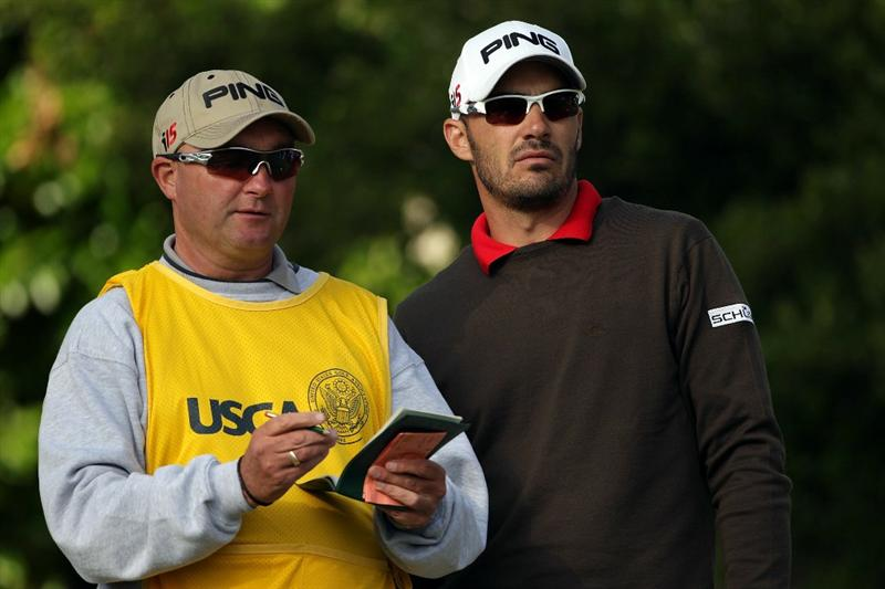 PEBBLE BEACH, CA - JUNE 19:  Gregory Havret of France waits with his caddie Garry Melia to hit his tee shot on the 16th hole during the third round of the 110th U.S. Open at Pebble Beach Golf Links on June 19, 2010 in Pebble Beach, California.  (Photo by Andrew Redington/Getty Images)