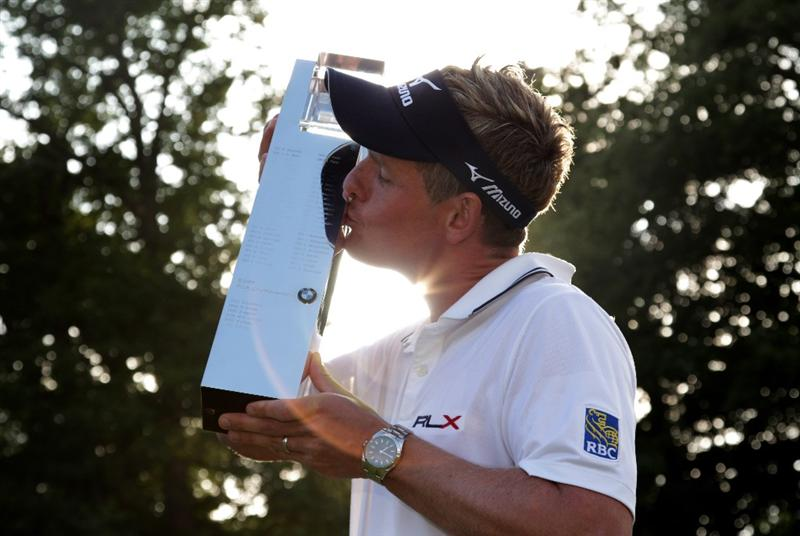 VIRGINIA WATER, ENGLAND - MAY 29:  Luke Donald of England holds the trophy following his victory in a playoff on the 18th green, which also secured him the Number one World ranking during the final round of the BMW PGA Championship  at the Wentworth Club on May 29, 2011 in Virginia Water, England.  (Photo by Ross Kinnaird/Getty Images)