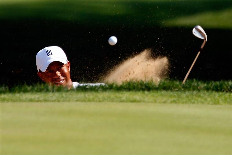 LEMONT, IL - SEPTEMBER 11:  Tiger Woods hits a bunker shot on the 11th hole during the second round of the BMW Championship held at Cog Hill Golf & CC on September 11, 2009 in Lemont, Illinois.  (Photo by Scott Halleran/Getty Images)