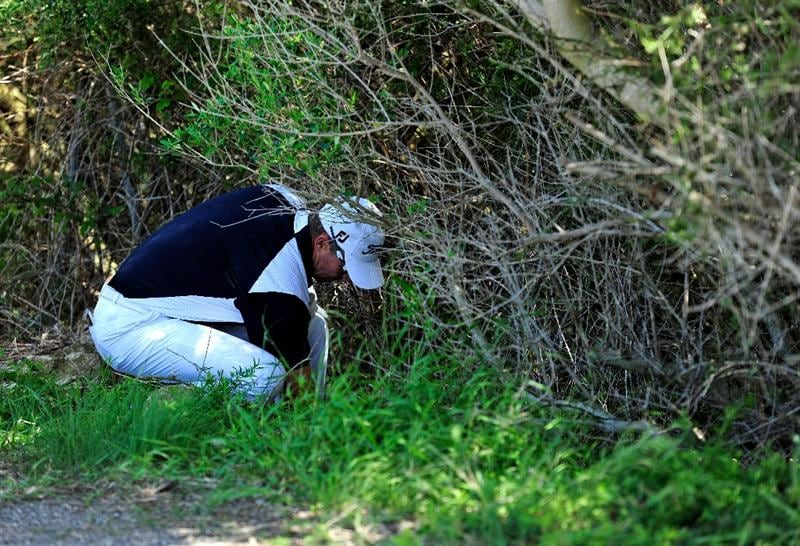 MALLORCA, SPAIN - MAY 15:  James Kingston of South Africa searches for his ball on the 10th hole during the third round of the Open Cala Millor Mallorca at Pula golf club on May 15, 2010 in Mallorca, Spain.  (Photo by Stuart Franklin/Getty Images)
