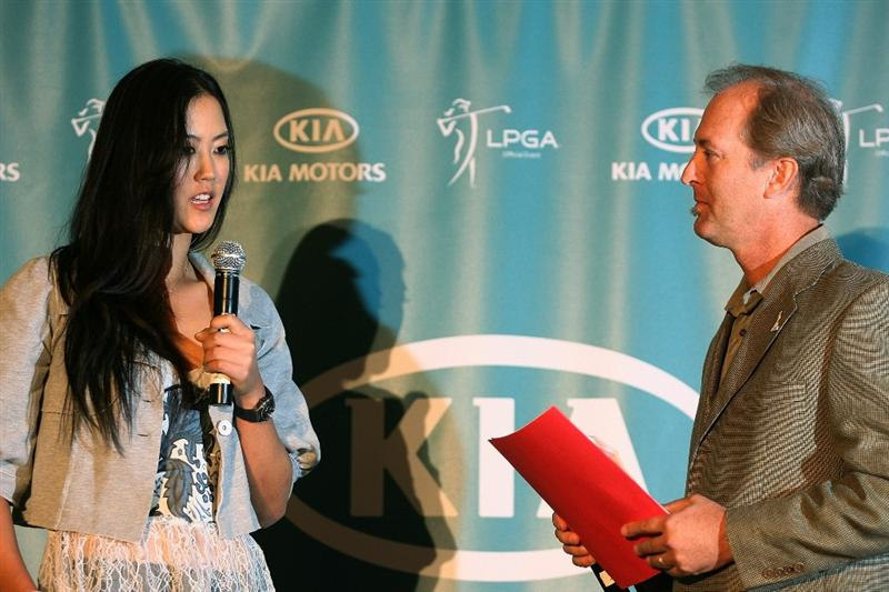 CITY OF INDUSTRY, CA - SEPTEMBER 18:  Michelle Wie answers a question from Tournament Director Jim Felechner at a press conference to announce the Kia Classic LPGA event to be held in March of 2011 on September 18, 2010 at Industry Hills Golf Club at Pacific Palms in City of Industry, California.  (Photo by Jeff Golden/Getty Images)
