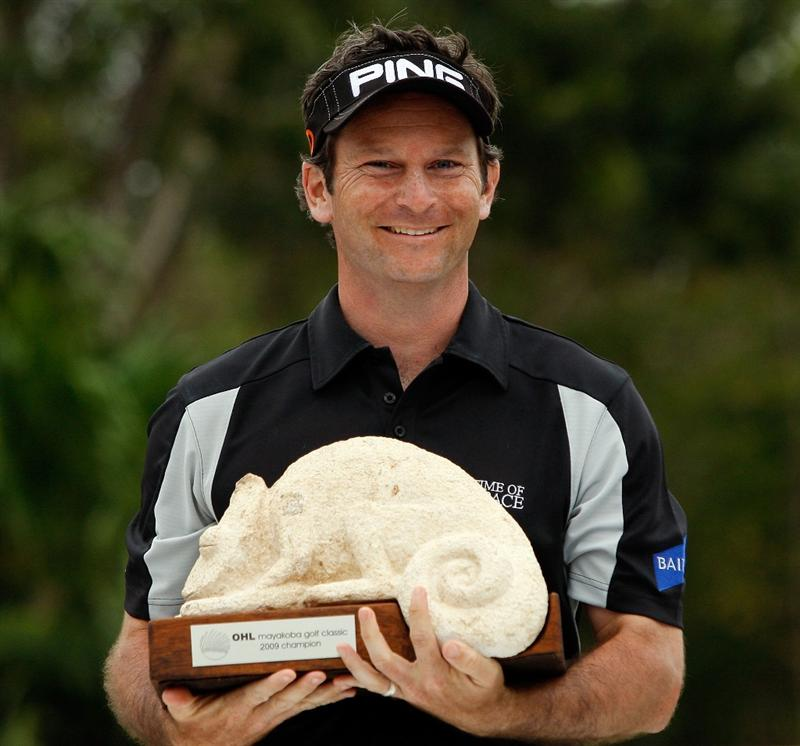 RIVIERA MAYA, MEXICO - MARCH 01:  Mark Wilson celebrates with the winner's trophy after the final round of the Mayakoba Golf Classic on March 1, 2009 at El Camaleon Golf Club in Riviera Maya, Mexico.   Wilson finished the day with a 68, for a total of 13 under par over second place J.J. Henry at 11 under par.  (Photo by Chris Graythen/Getty Images)