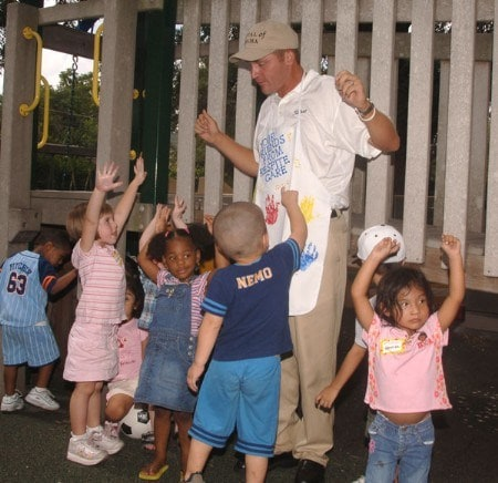 Jason Bohn poses with children at the Respite Care in San Antonio, Texas September 20, 2005 during the PGA TOUR's Player Charity Visit for the 2005 Valero Texas Open.Photo by Steve Grayson/WireImage.com
