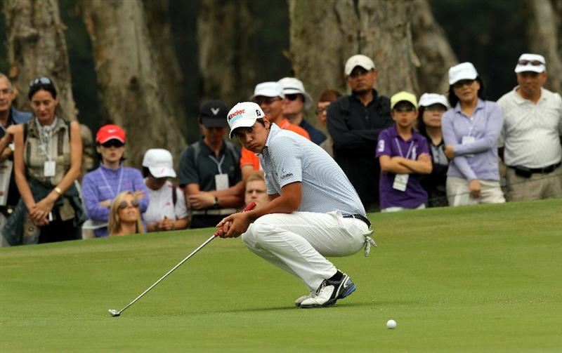 HONG KONG - NOVEMBER 20:  Matteo Manassero of Italy reacts after a putt during day three of the UBS Hong Kong Open at The Hong Kong Golf Club on November 20, 2010 in Hong Kong, Hong Kong.  (Photo by Stanley Chou/Getty Images)