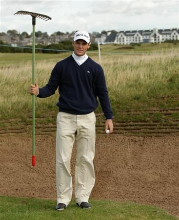 CARNOUSTIE, SCOTLAND - OCTOBER 06:  Martin Kaymer of Germany holds a bunker rake during a practice round for The Alfred Dunhill Links Championship at Carnoustie Golf Links on October 6, 2010 in Carnoustie, Scotland.  (Photo by Andrew Redington/Getty Images)