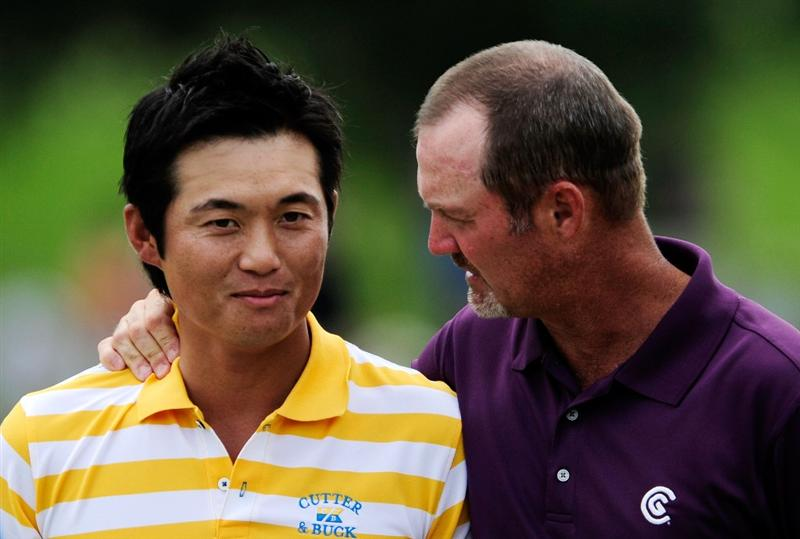PONTE VEDRA BEACH, FL - MAY 07:  (L-R) Ryuji Imada of Japan talks with Jerry Kelly on the 18th green after shooting a six-under-par 66 during the second round of THE PLAYERS Championship held at THE PLAYERS Stadium course at TPC Sawgrass on May 7, 2010 in Ponte Vedra Beach, Florida.  (Photo by Sam Greenwood/Getty Images)