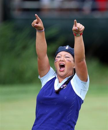 SUGAR GROVE, IL - AUGUST 21:  Christina Kim of the USA celebrates winning her match with Natalie Gulbis on the 16th green during the Friday afternoon foursome matches at the 2009 Solheim Cup Matches, at the Rich Harvest Farms Golf Club on August 21, 2009 in Sugar Grove, Ilinois  (Photo by David Cannon/Getty Images)