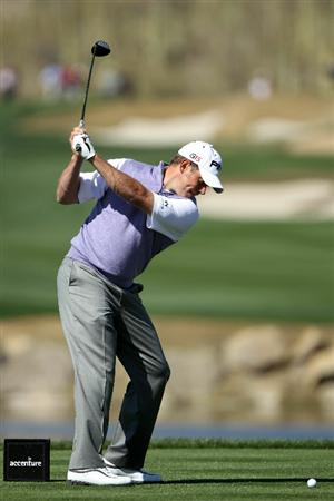 MARANA, AZ - FEBRUARY 23:  Lee Westwood of England hits his tee shot on the fourth hole during the first round of the Accenture Match Play Championship at the Ritz-Carlton Golf Club on February 23, 2011 in Marana, Arizona.  (Photo by Andy Lyons/Getty Images)