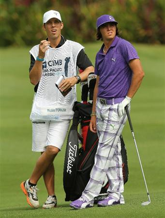 KUALA LUMPUR, MALAYSIA - OCTOBER 29: Rickie Fowler of USA and his caddies waits on the 13th hole during day two of the CIMB Asia Pacific Classic at The MINES Resort & Golf Club on October 29, 2010 in Kuala Lumpur, Malaysia.  (Photo by Stanley Chou/Getty Images)